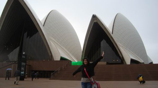 Rain pouring down at Sydney Opera House. I had a chinese man take my picture.