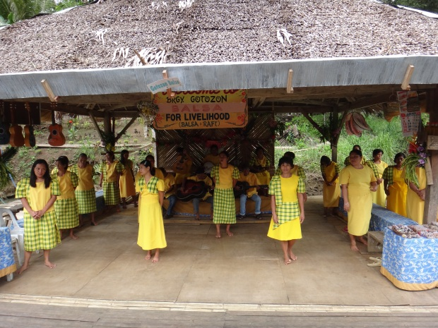 Locals singing and dancing for tourists