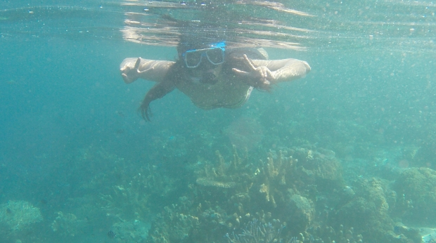 My sister snorkeling at Coral Garden