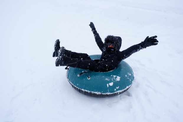 My mom snow tubing at Hanazono